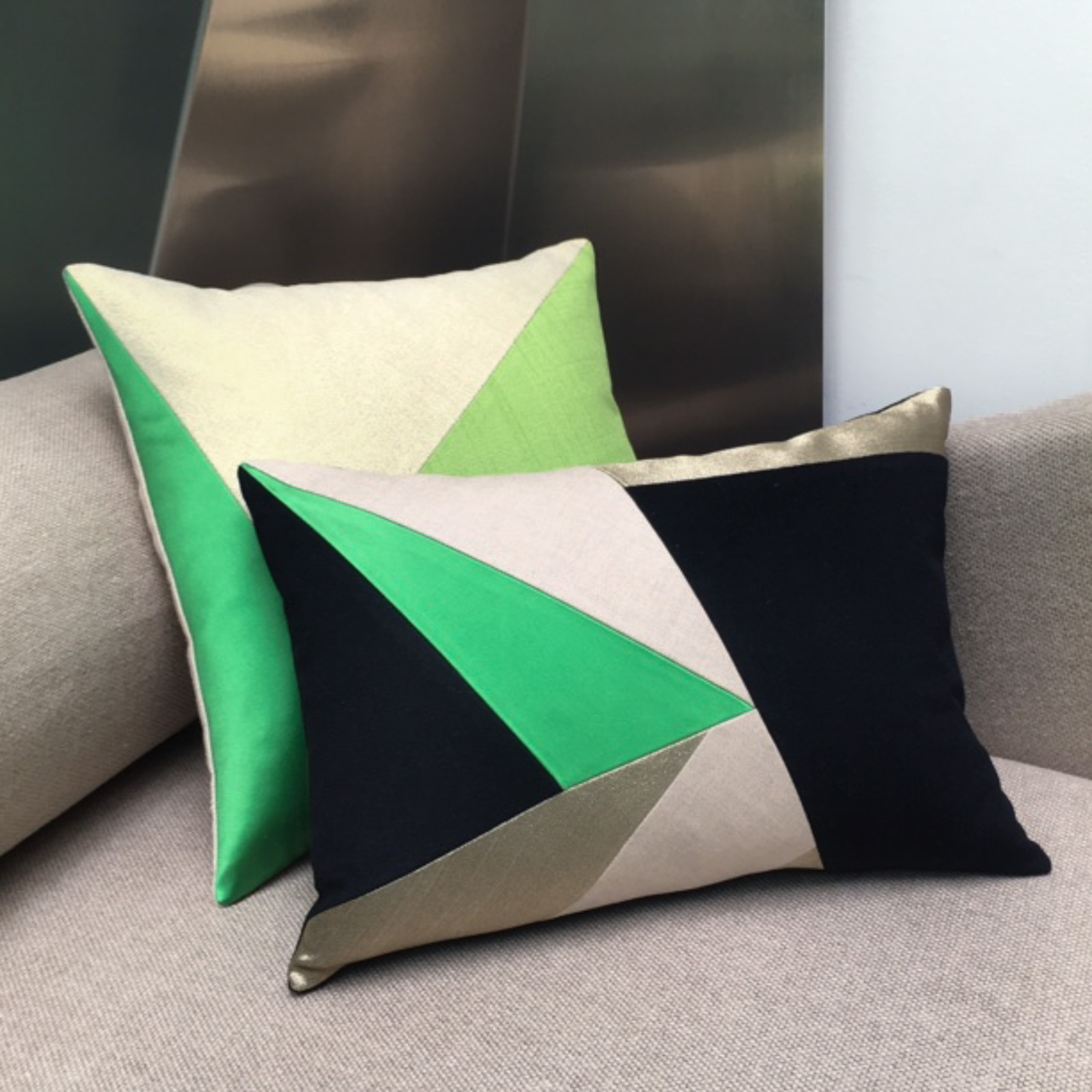 designer cushions green and geometric